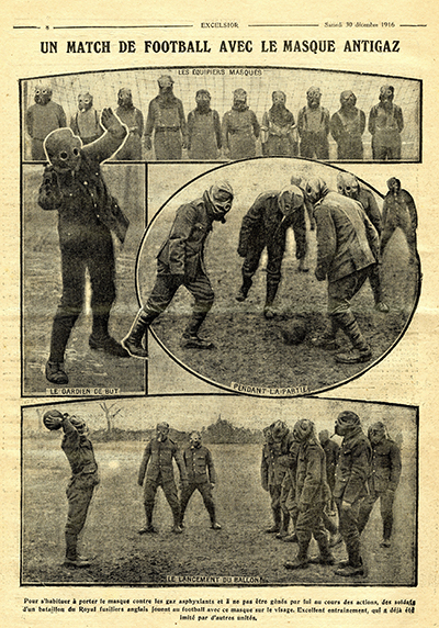 Soldiers play football with gas masks on