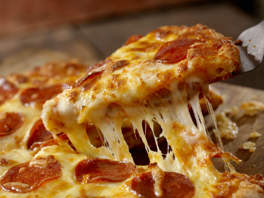 pizza with stringy cheese