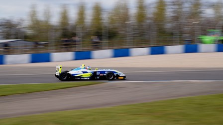 UWR Race Team car shot in motion at Donington Park in F3 Cup Championship.