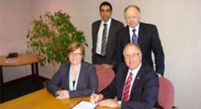 Fiona Turner, Personnel Manager at ZF Lenforder UK ltd and Terry Somerfield, Managing Director of ZF Lemforder UK ltd; Standing L-R -Jatinder Sharma, Chief Executive of Walsall College abd Pro Vicfe-Chancellor Research and Enterpriseat the UOW Professor Ian Oakes.