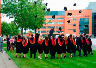 Students throwing their caps in the air for graduation