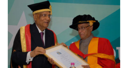 Mr Pranab Mukherjee (right)receives his honorary degree from Lord Swraj Paul