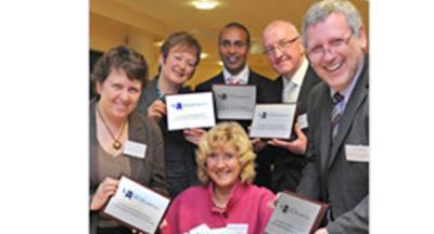 Prof. Caroline Gipps (centre). L-R: Beverly Tyley, Brenda Shelis, Amarjit Basi, Roger Minnet and Ian Milard.