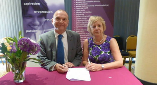 OCNWMR - Vice-Chancellor of the University of Wolverhampton, Professor Geoff Layer and CEO of the Open College Network West Midlands Region Chris Assheton signing the progression information documents agreement.