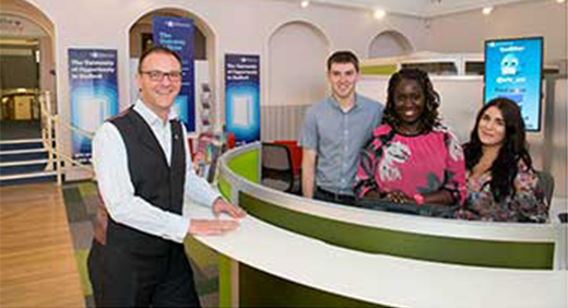 Jon Elsmore with staff members at The Gateway Oliver Speke and Monica Belhouche
