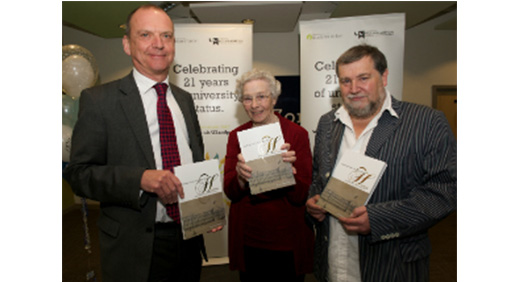 Vice-Chancellor, Professor Geoff Layer, Sheila Holgate-Wright and Professor Mike Haynes with the copies of 'Opening Doors in the Heartlands: A History of the University of Wolverhampton'.