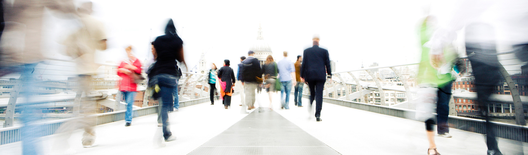 Research, Doctoral College, case studies, student and alumni profiles, people walking, blurred, bridge