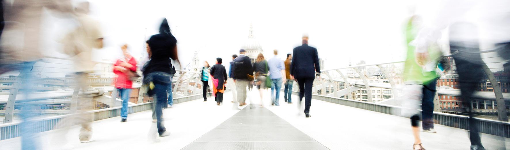 Research, Doctoral College, case studies, student and alumni profiles, people walking, blurred, bridge