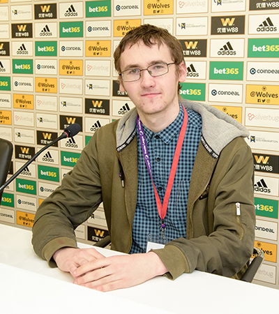 Andrew Rigby sitting at the Wolverhampton Wanderers press conference desk.
