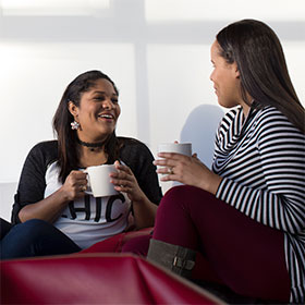 Two students drinking coffee